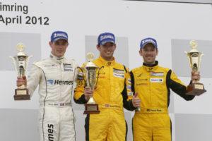 Porsche Carrera Cup Deutschland 2012 2.Lauf Kévin Estre (F), Sean Edwards (GB),René Rast (D) auf dem Podium