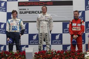 Porsche  Supercup Bahrain 2012 Christian Engelhart Norbert Siedler und Rene Rast auf dem Podium